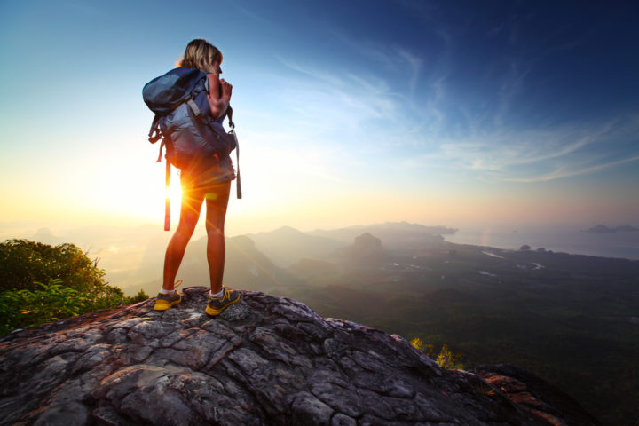 How to Choose Unique Travel Destinations Young lady hiker